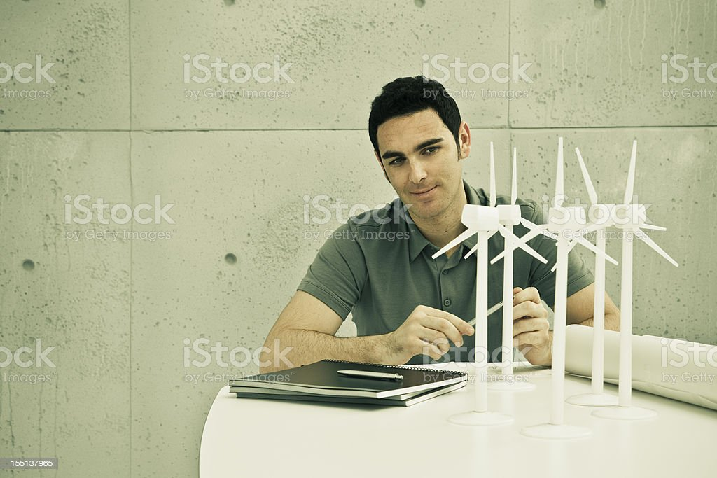 Eco engineer with wind turbines royalty-free stock photo