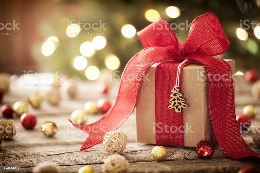 Eco enviornmentally friendly, holiday christmas gift, on rustic wood table stock photo