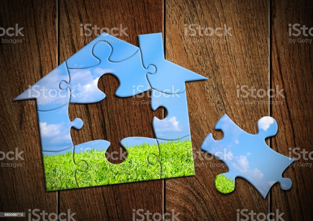 Eco house concept, home from puzzle stock photo