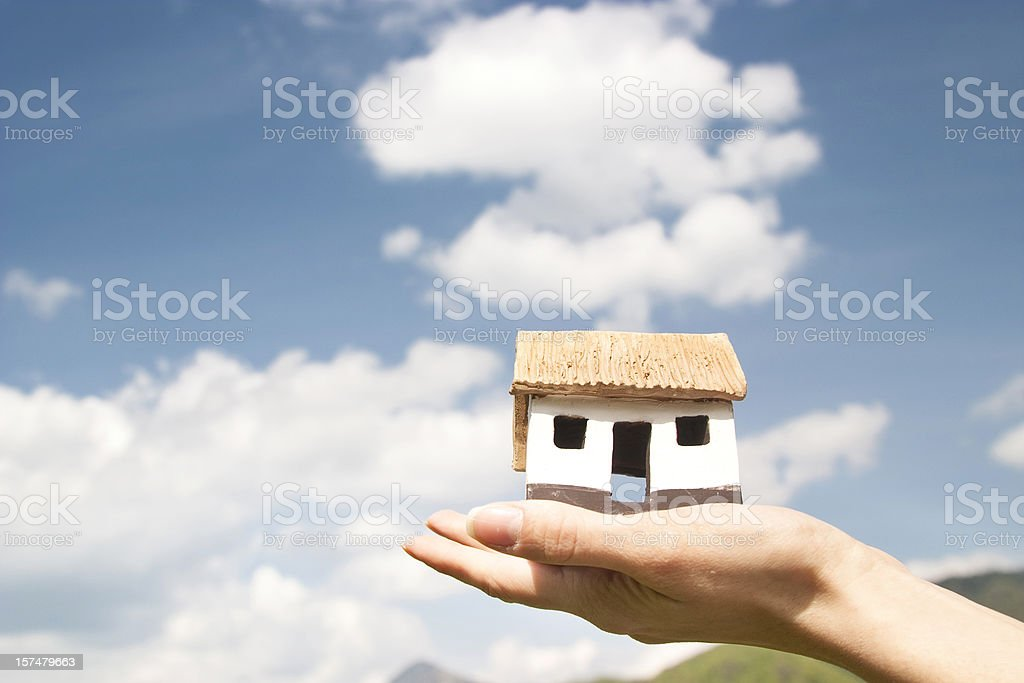 Eco house scale model in the sky royalty-free stock photo