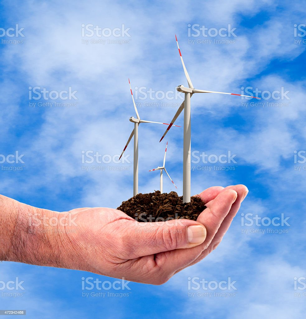 Eco power, wind turbines in the hand stock photo