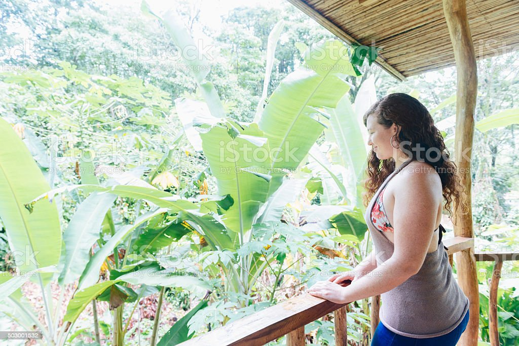 Eco Tourist Enjoys View from Window in Costa Rica Jungle stock photo