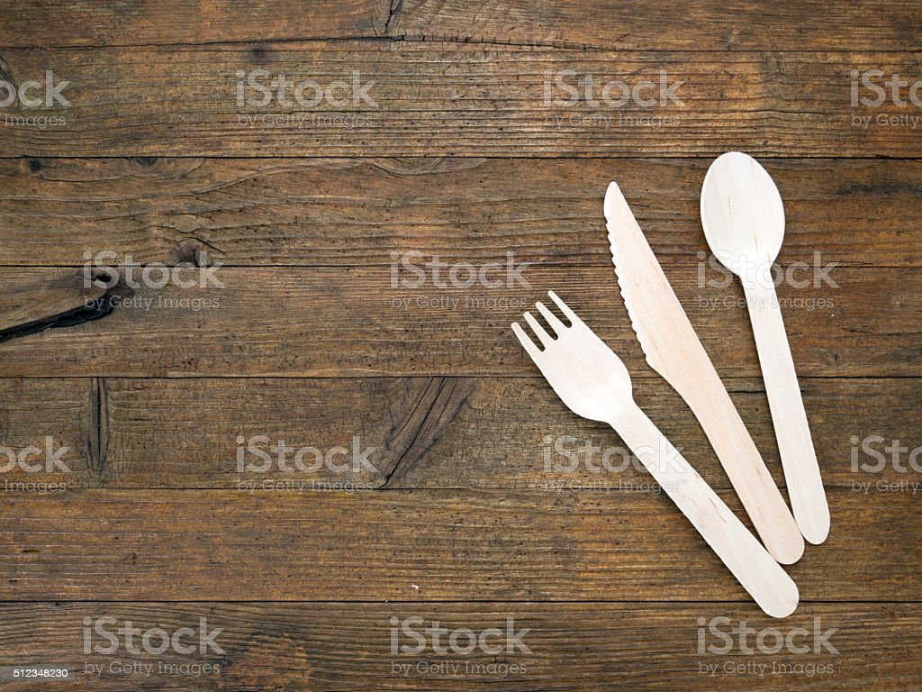 Eco-friendly disposable cutlery on rustic wooden table. stock photo