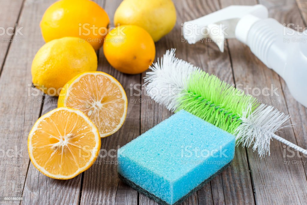 Eco-friendly natural cleaners baking soda, lemon and cloth on wooden table stock photo