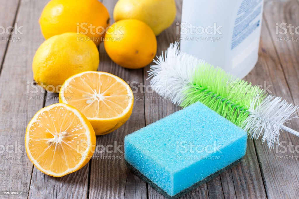 Eco-friendly natural cleaners on wooden table stock photo