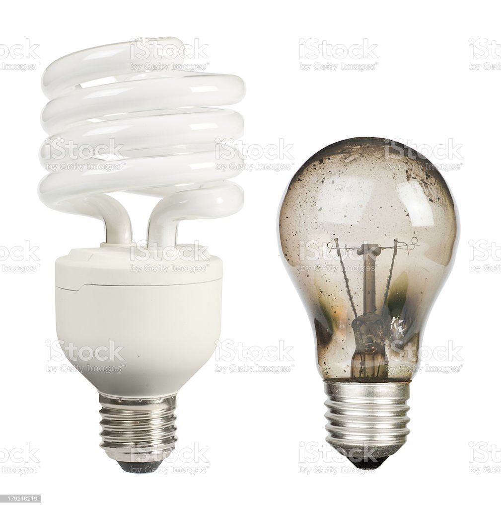 Ecological economical lamp and old burned stock photo