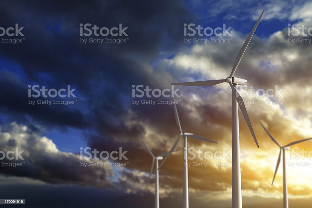 Ecological power generation. Windmills on sunset. royalty-free stock photo