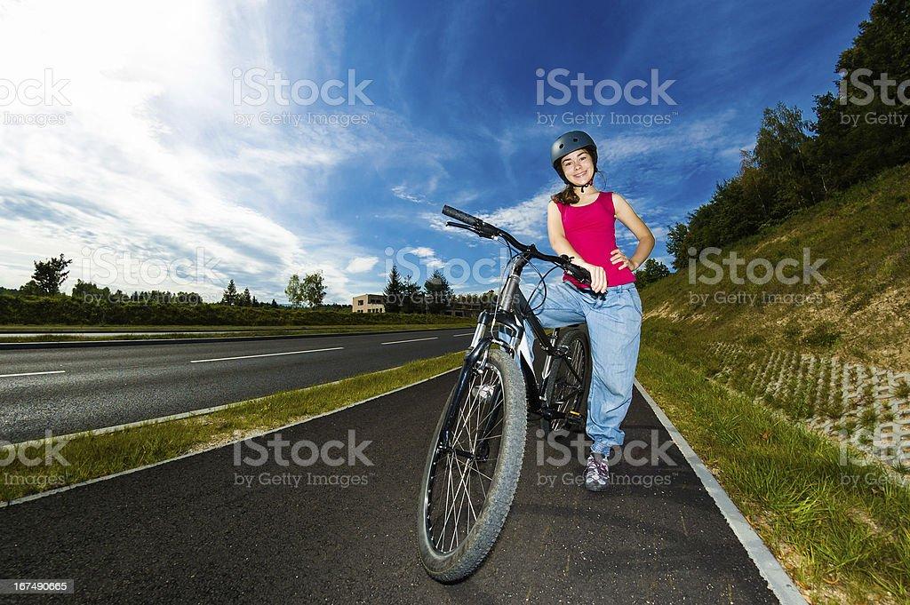 Ecological transportation - girl biking royalty-free stock photo
