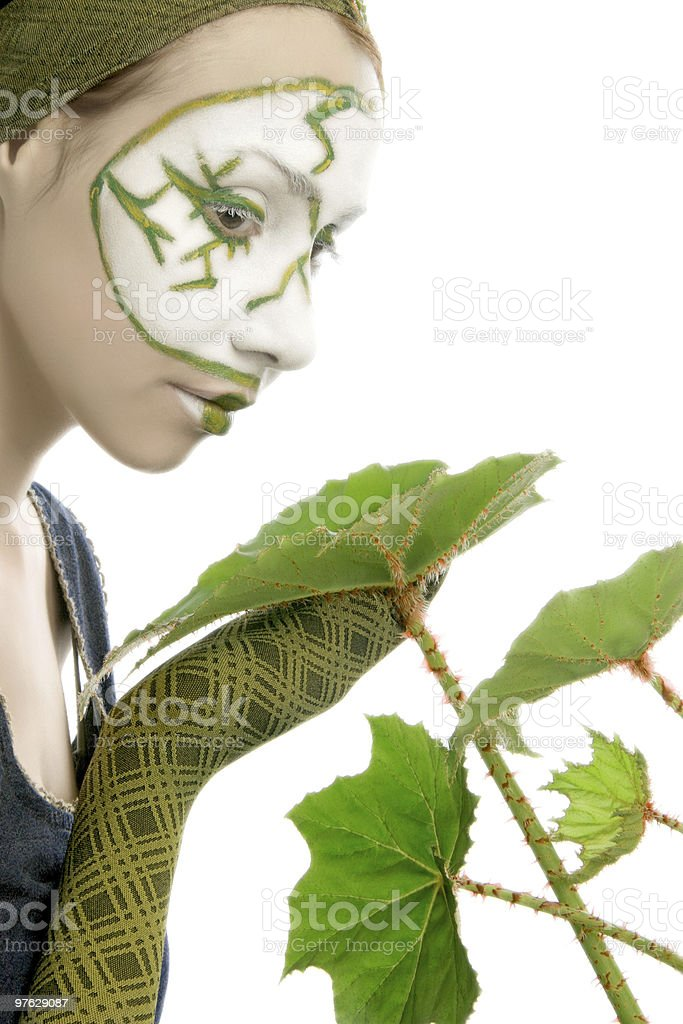 Ecological woman with green plant royalty-free stock photo