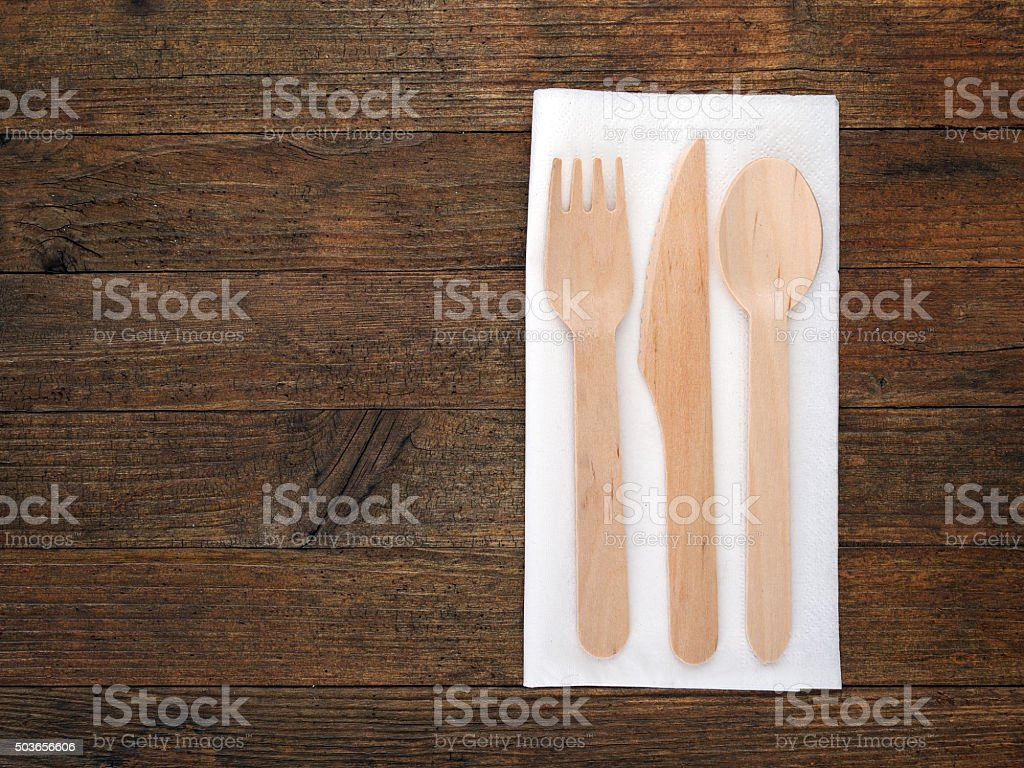 Ecological wooden disposable cutlery on rustic board stock photo