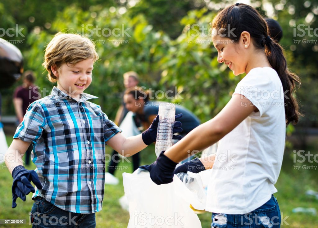 Ecology group of people cleaning the park stock photo