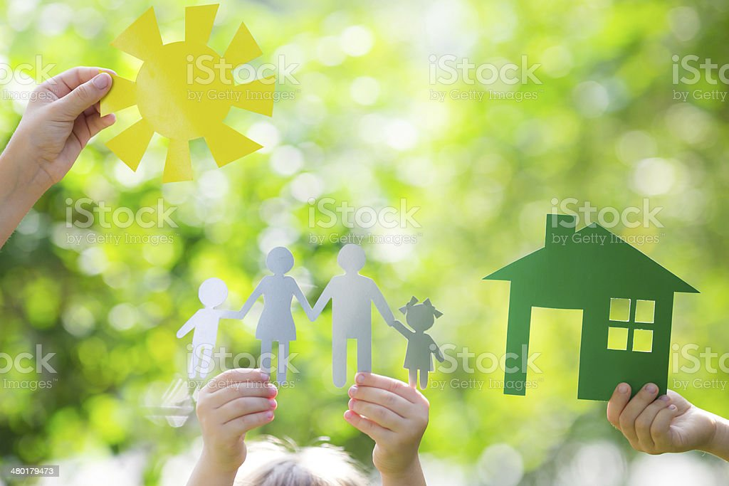 Ecology house in hands stock photo