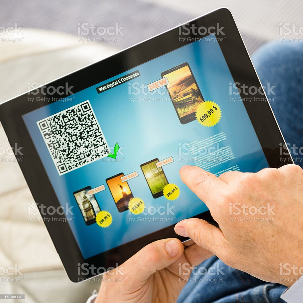 e-commerce  - Choosing a smatphone with digital tablet royalty-free stock photo