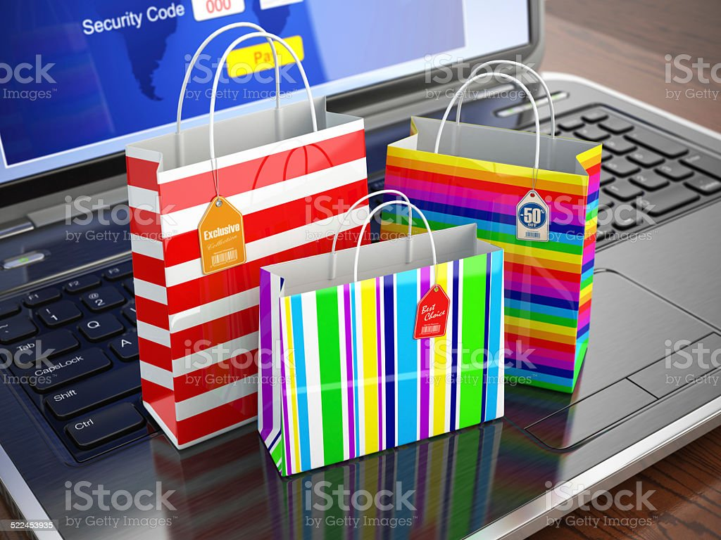 E-commerce concept. Colourful paper striped shopping bags on lap stock photo