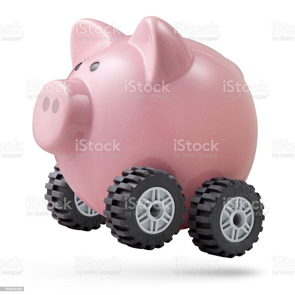 Economic acceleration. Piggy bank on wheels. stock photo