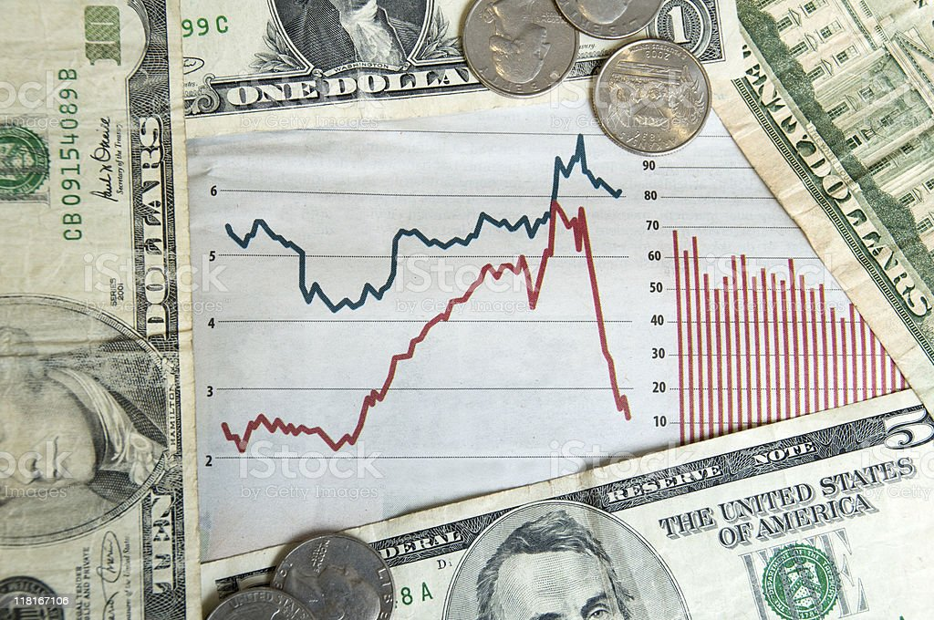 Economic Depression with fallen stock prices and dollar bills royalty-free stock photo