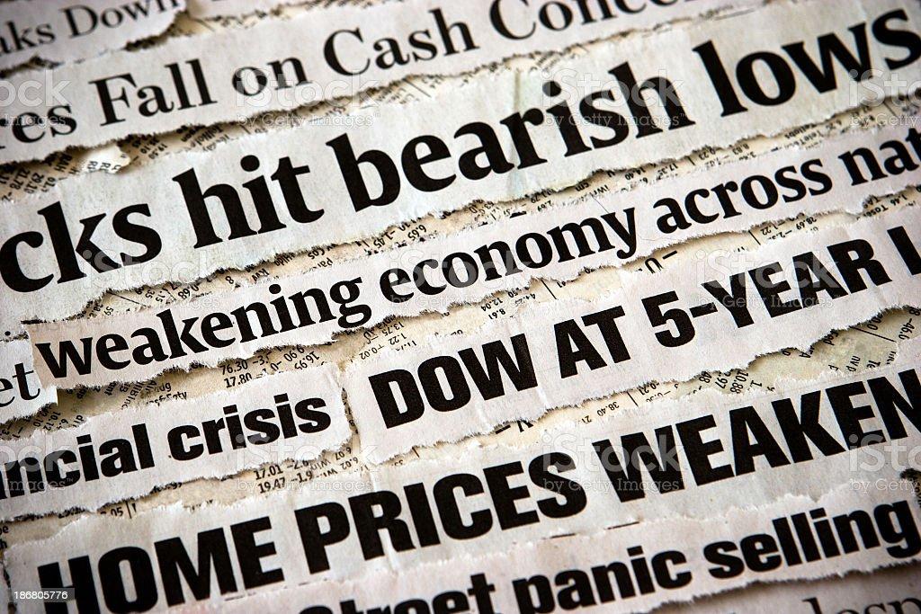 Economic headlines surrounding each other stock photo