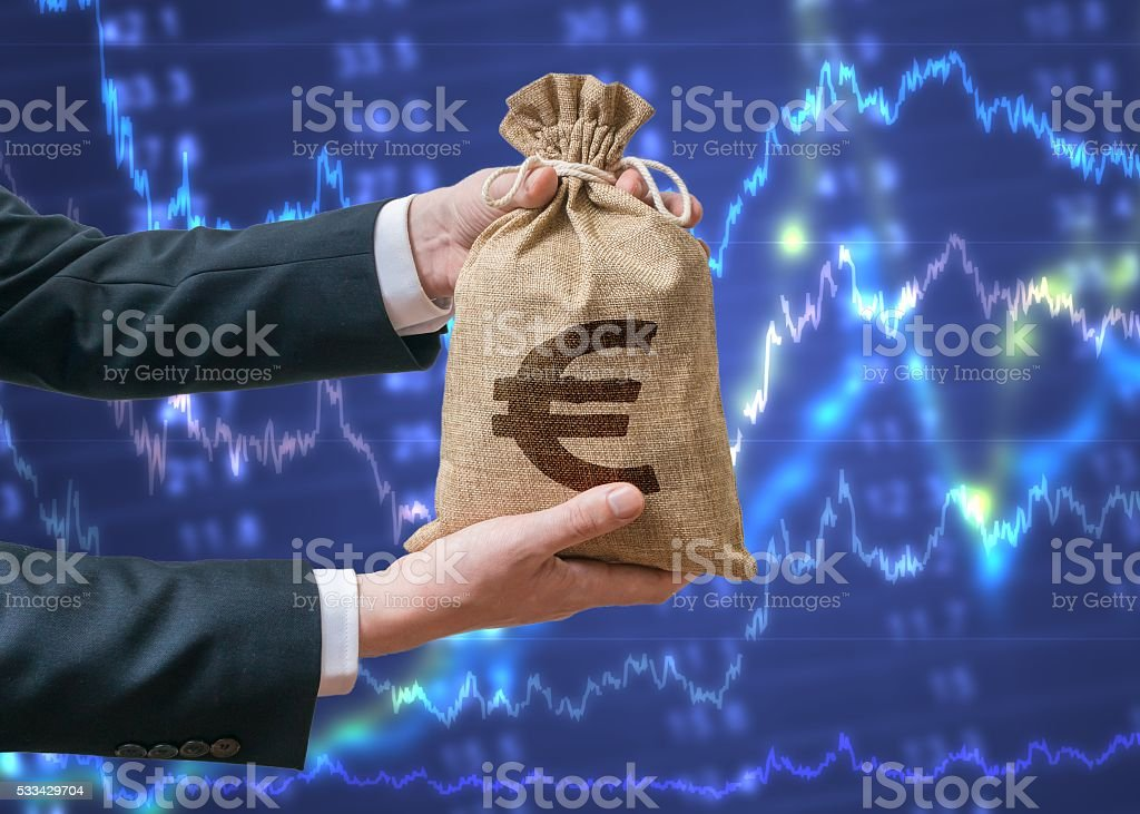 Economics of Eurozone. Businessman holds bag with money with Euro. stock photo