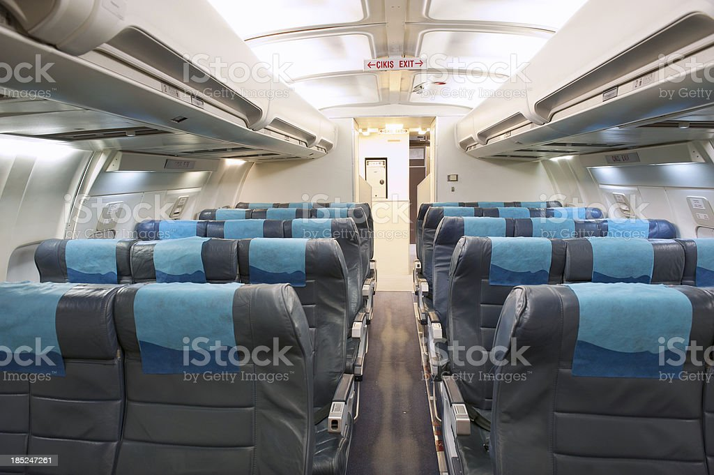 Economy Class Seating Inside An Airplane Cabin stock photo