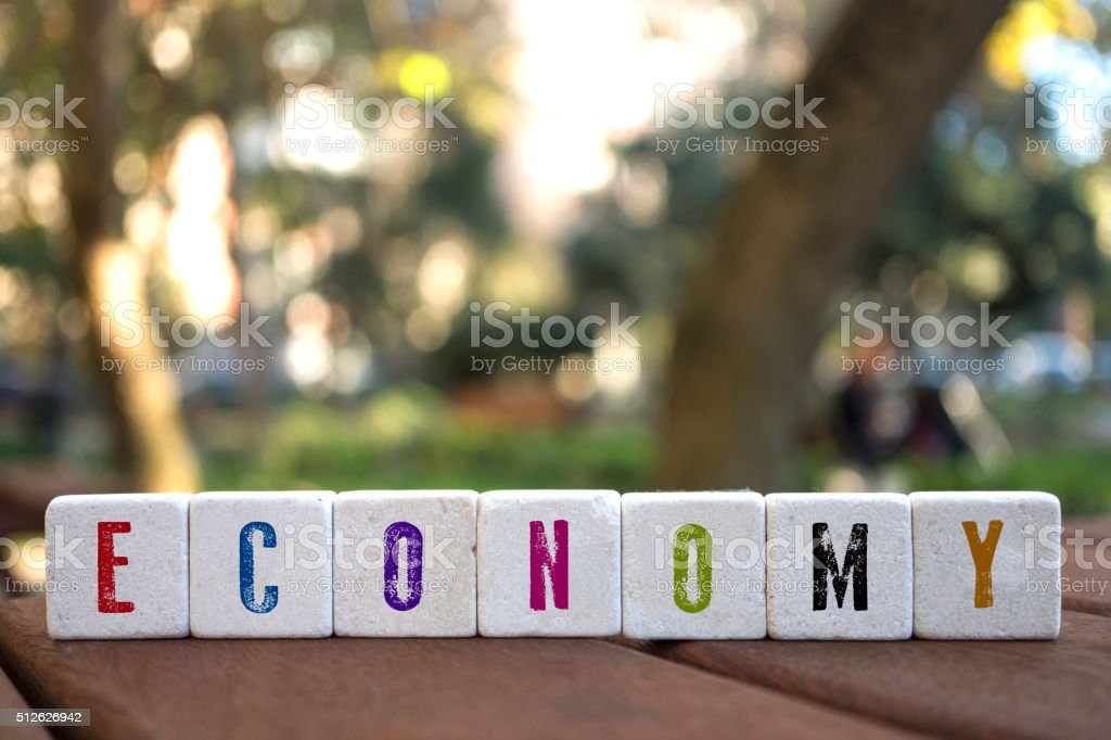 Economy Concept with alphabet blocks stock photo