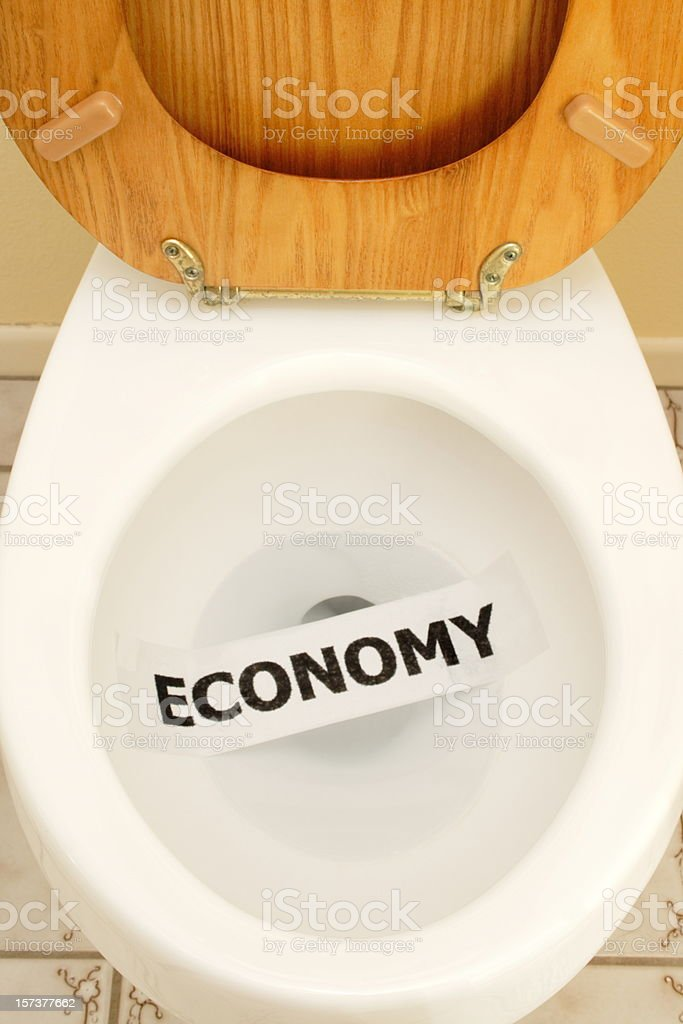 Economy in the Toilet--Close Up stock photo