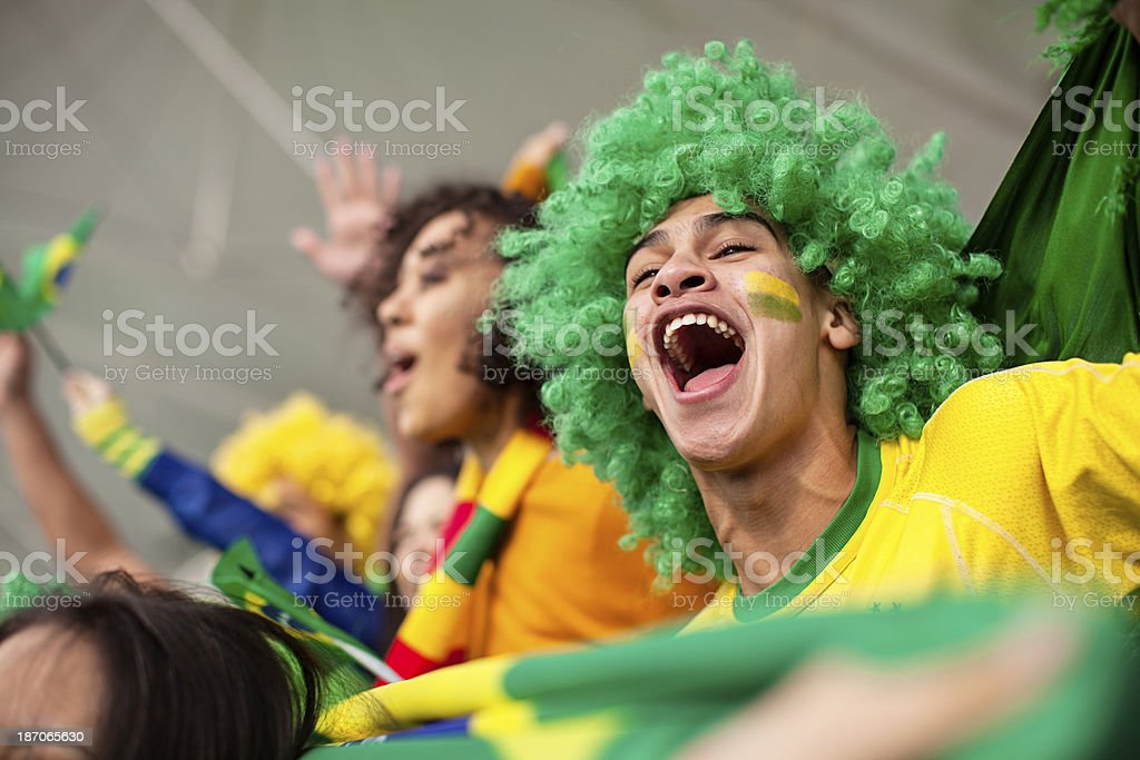 Ecstatic Brazilian fan watching a Football game royalty-free stock photo