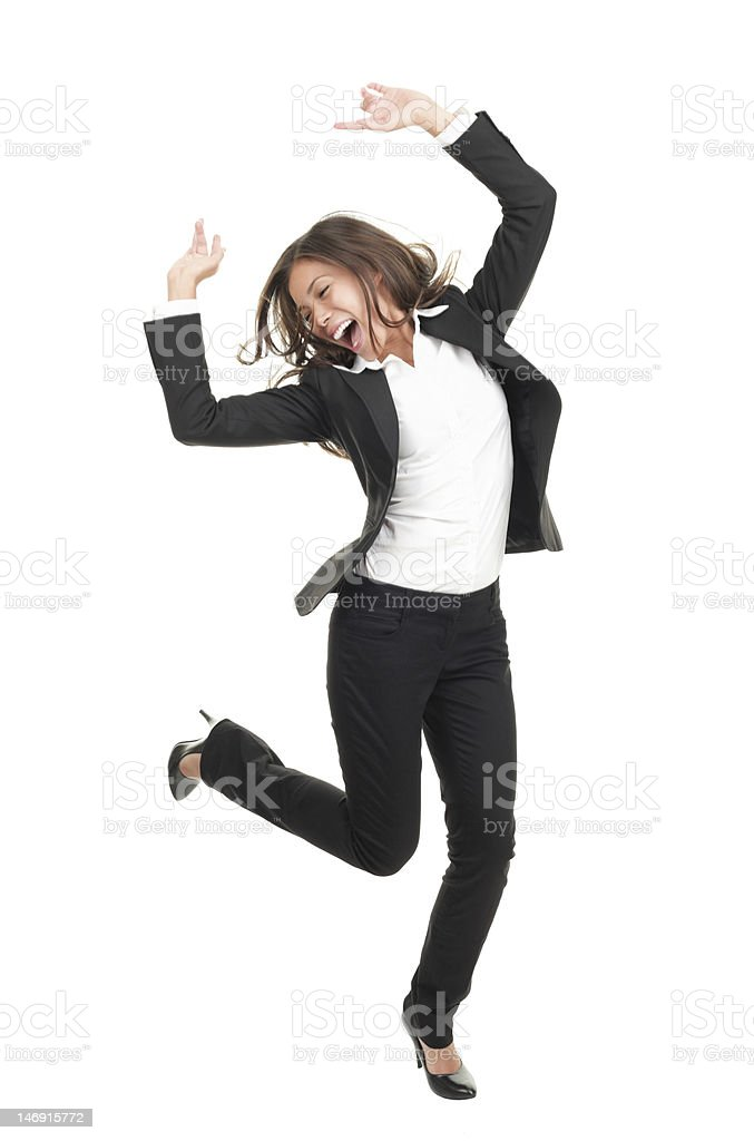 ecstatic businesswoman in suit dancing stock photo