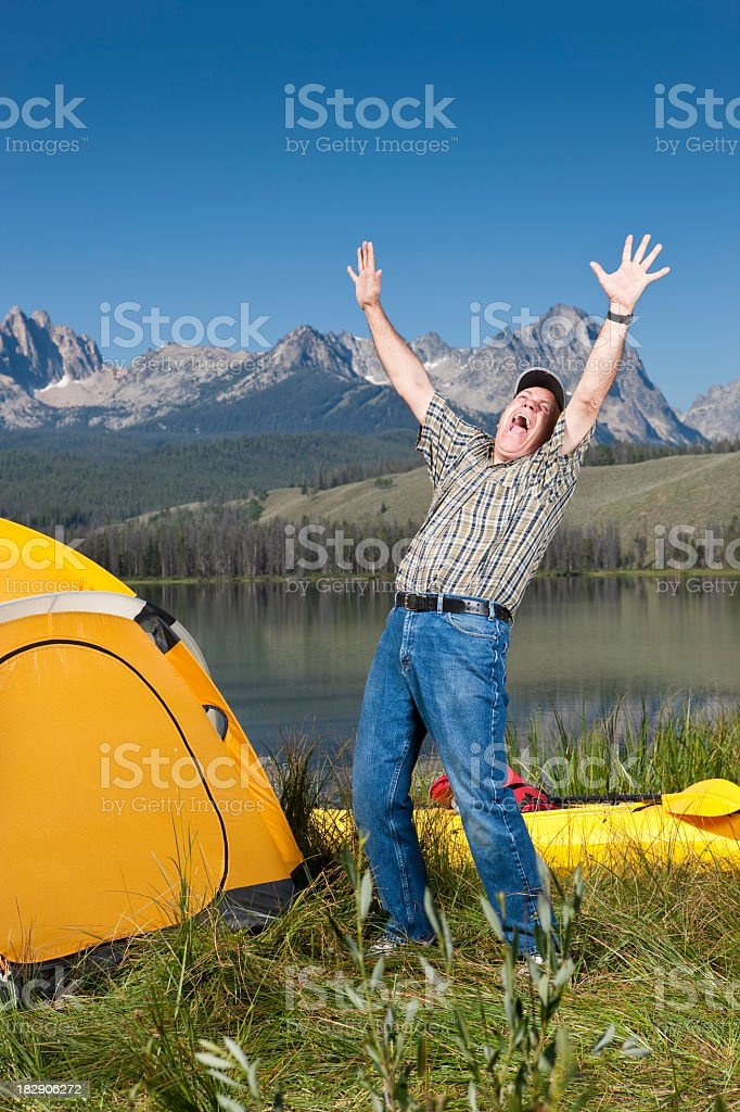 Ecstatic Camper by Lake royalty-free stock photo
