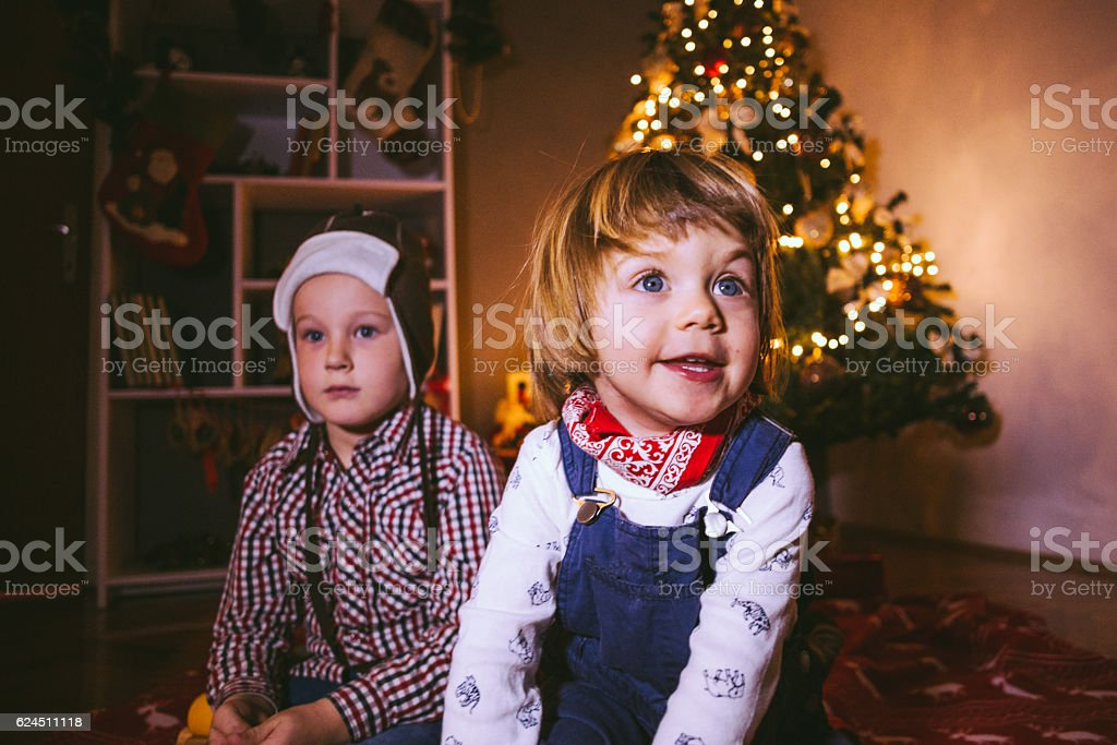 Ecstatic Children Celebrating Christmas stock photo
