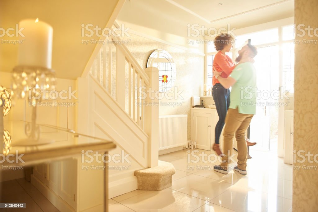 ecstatic couple in new home stock photo