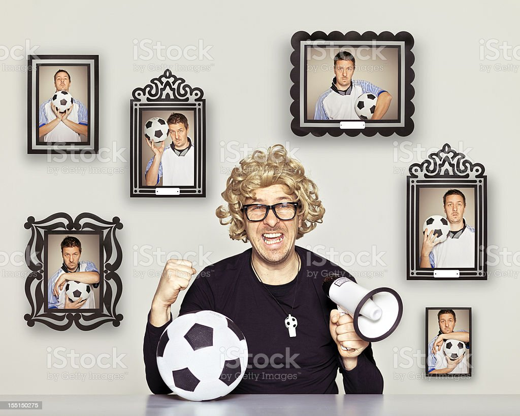 Ecstatic football fan and his football idol photographs on the wall.