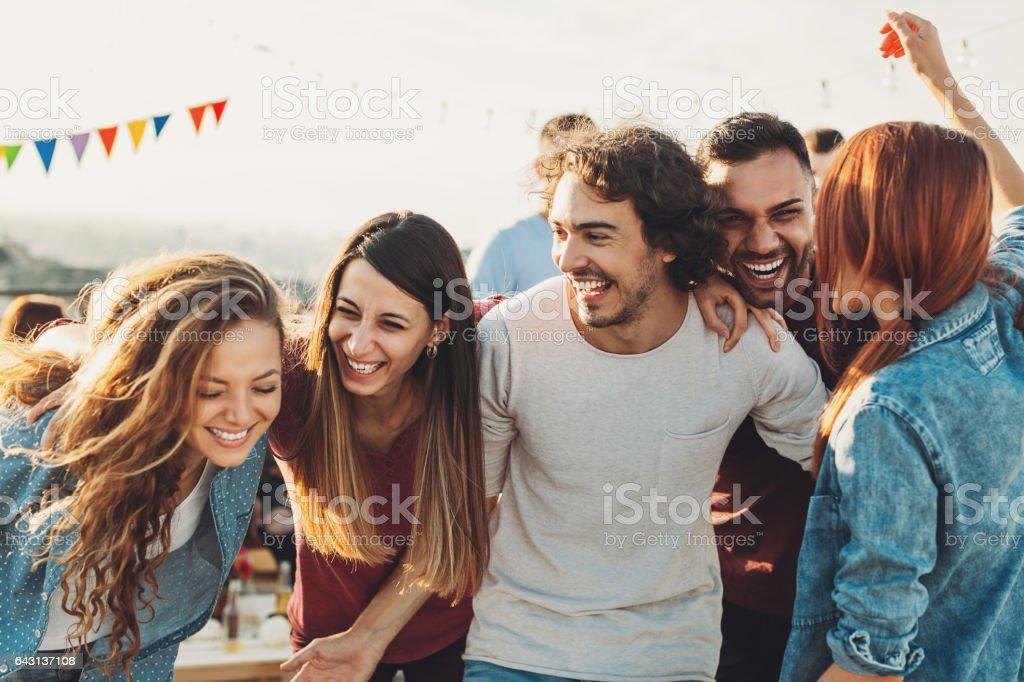 Ecstatic group enjoying the party stock photo
