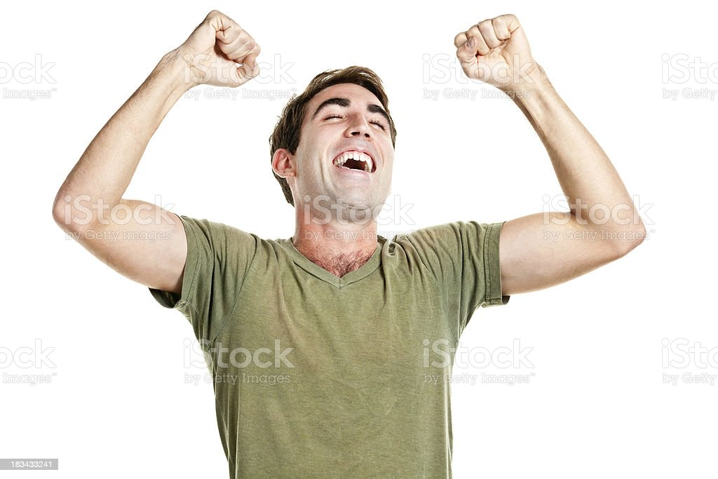 Ecstatic Happy Man Cheering And Shaking Fists stock photo