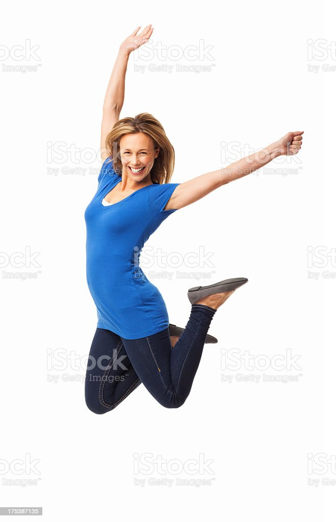Ecstatic Mid Adult Woman Jumping - Isolated stock photo