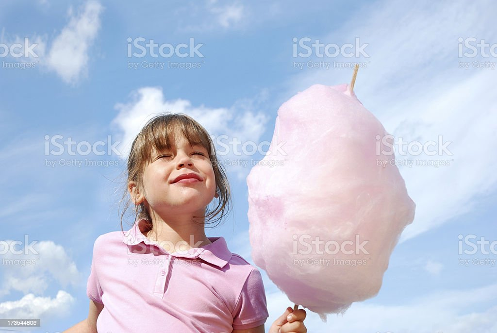 Girl holding cotton candy.Being a Kid Lightbox