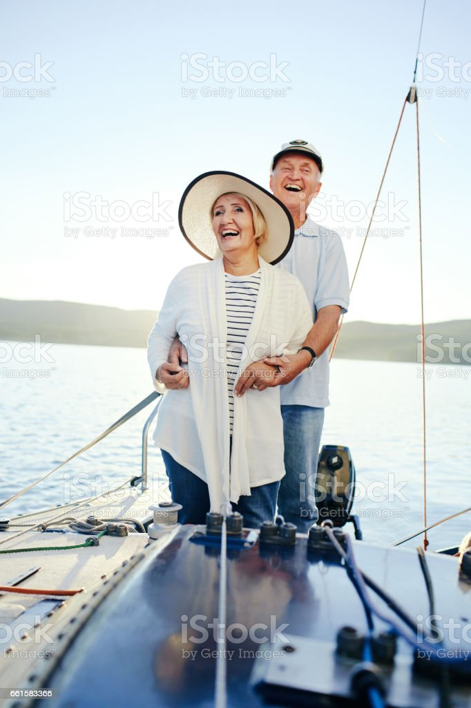 Laughing couple having romantic voyage on yacht