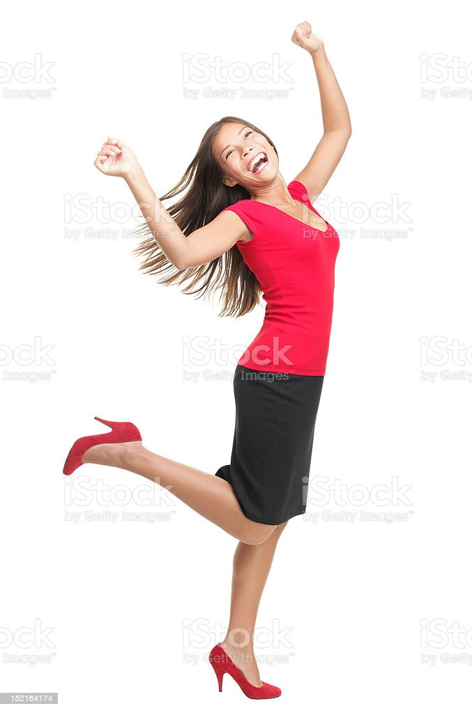 Ecstatic woman dancing of joy stock photo