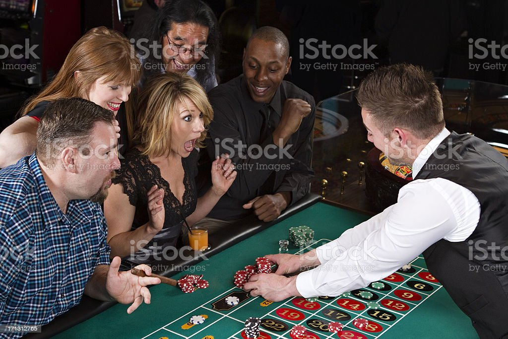Ecstatic Woman Winning At Roulette Table royalty-free stock photo