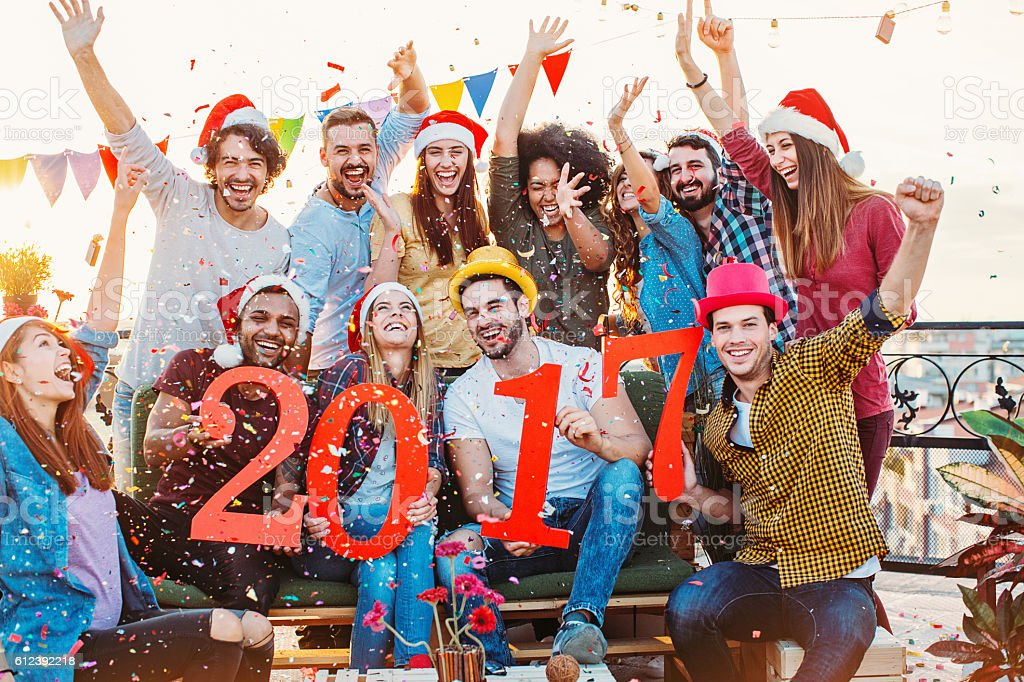 Ecstatic young people holding big red 2107 numbers stock photo