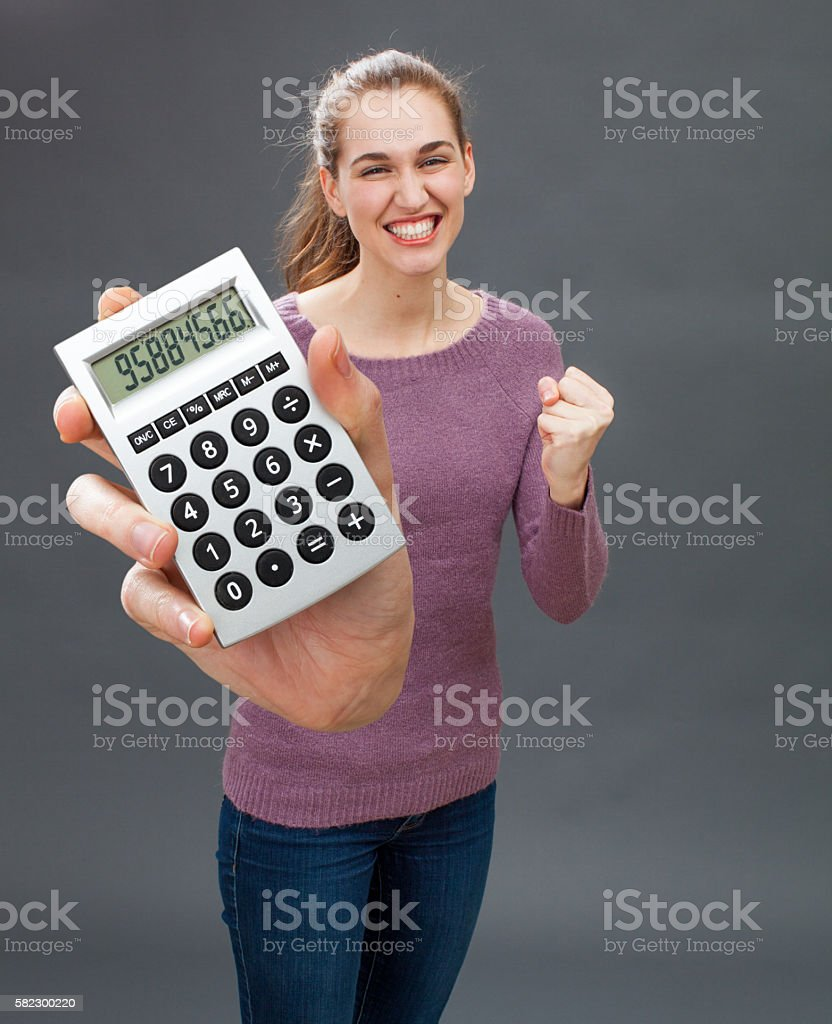 ecstatic young woman acting convinced and ambitious for economic success stock photo