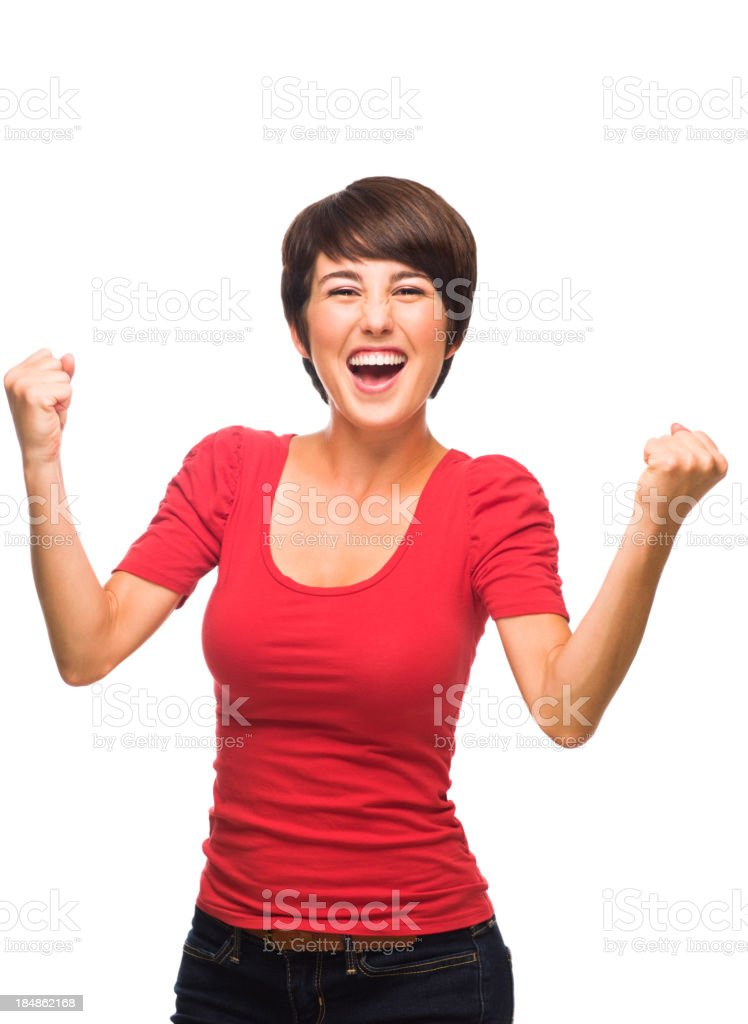 Ecstatic young woman celebrating royalty-free stock photo