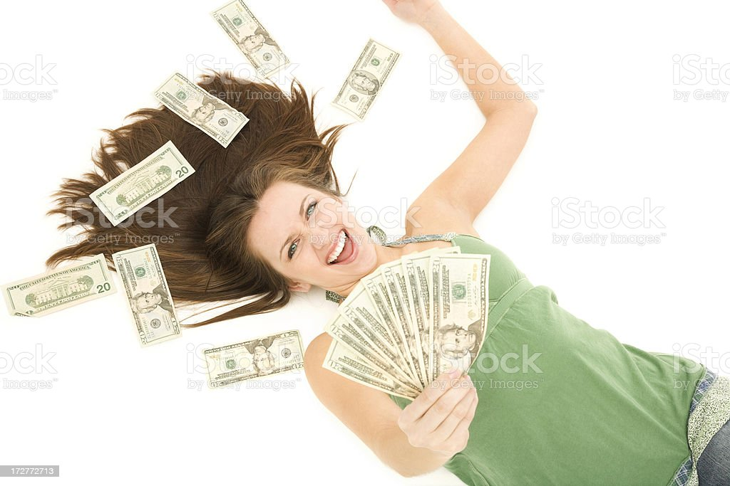 Ecstatic Young Woman Holding Money royalty-free stock photo