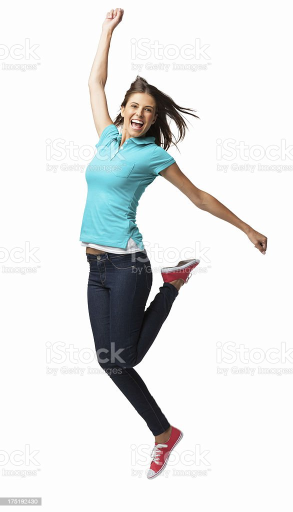 Ecstatic Young Woman Jumping - Isolated stock photo