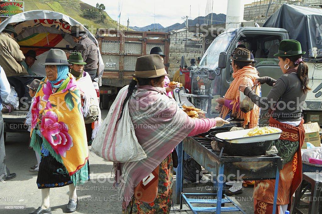 Ecuadorian ethnic people selling cooked food stock photo