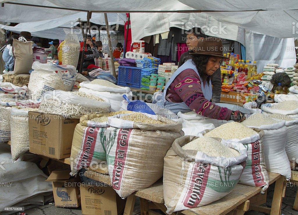 Ecuadorian ethnic woman selling rice stock photo