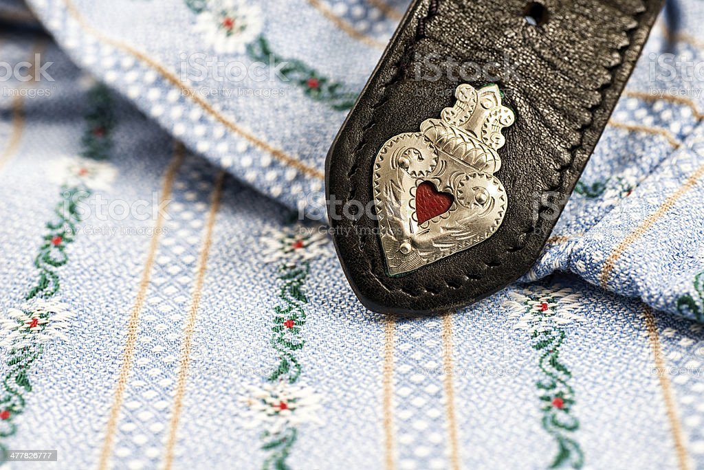 Edelweiss shirt with traditional black belt and heart shape stock photo