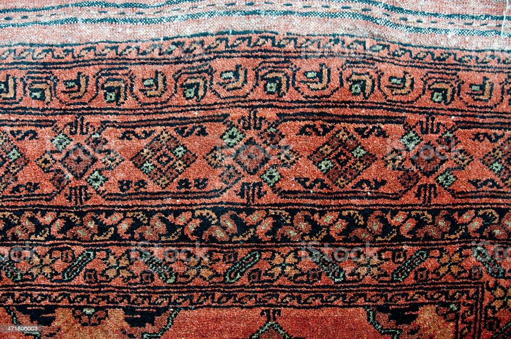 Edge of a brown tribal rug royalty-free stock photo