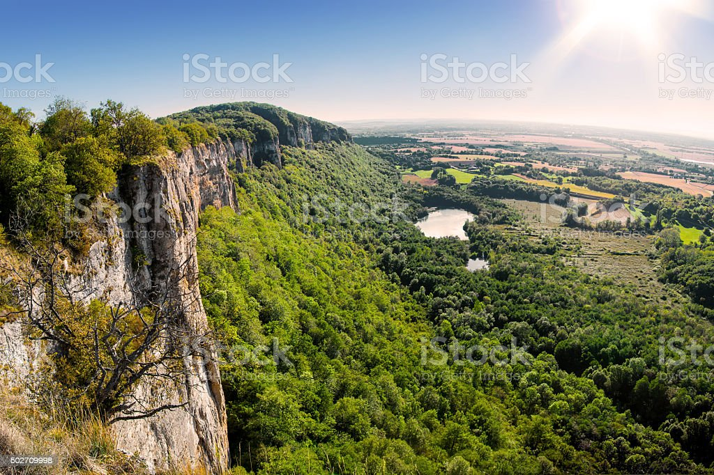 Edge of a steep cliff landscape in France during sunset stock photo