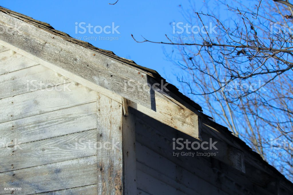 Edge of an Abandoned Farm Shed Against a Blue Sky stock photo