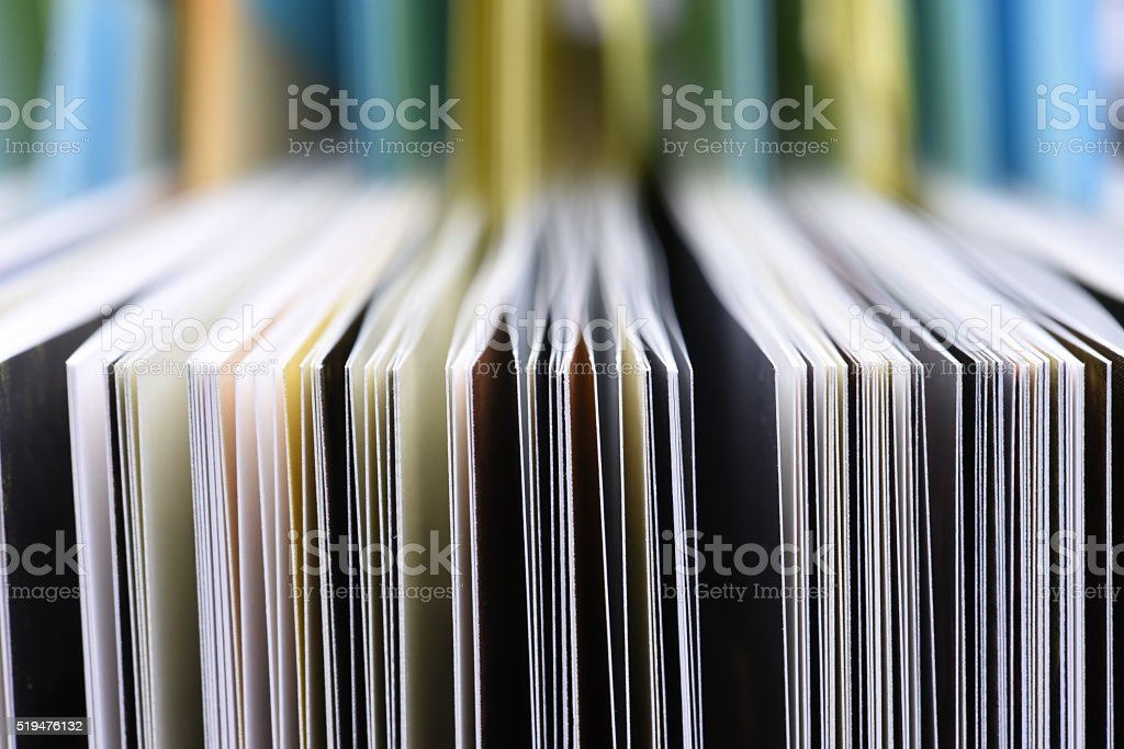 Edge of open book pages stock photo